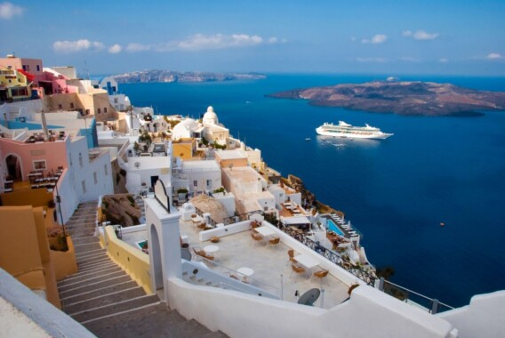 The island of Santorini. Morning view of the harbor, the volcano and Thira